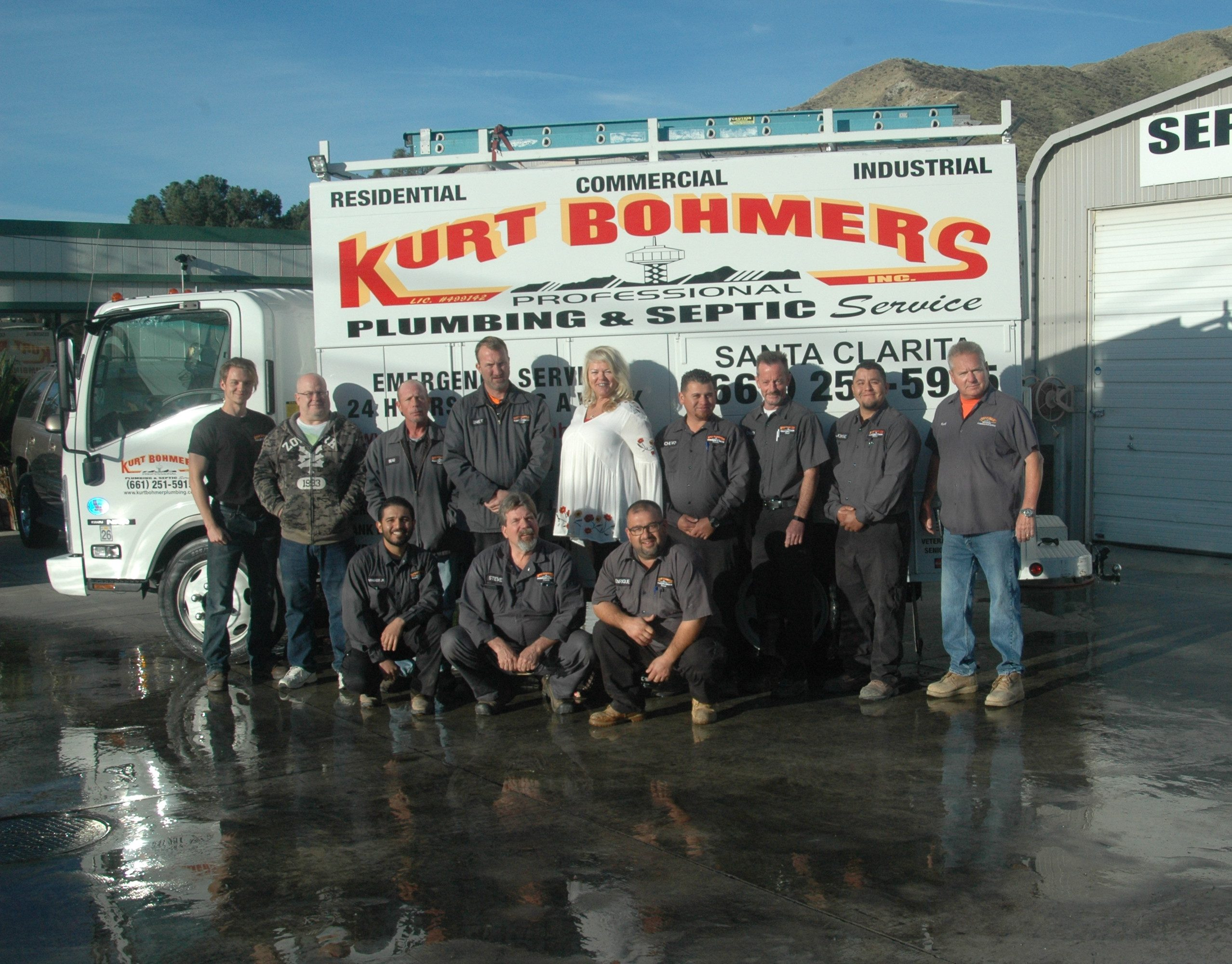 Kurt Bohmers Plumbing team photo standing in front of truck